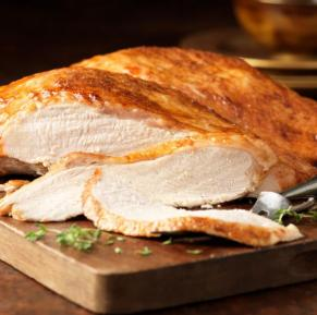 How did turkey become the favorite bird for festive seasons?
